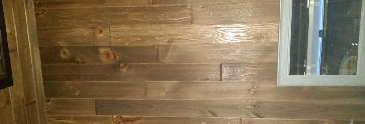 Distressed pine end matched tongue and groove Lumber that is stained